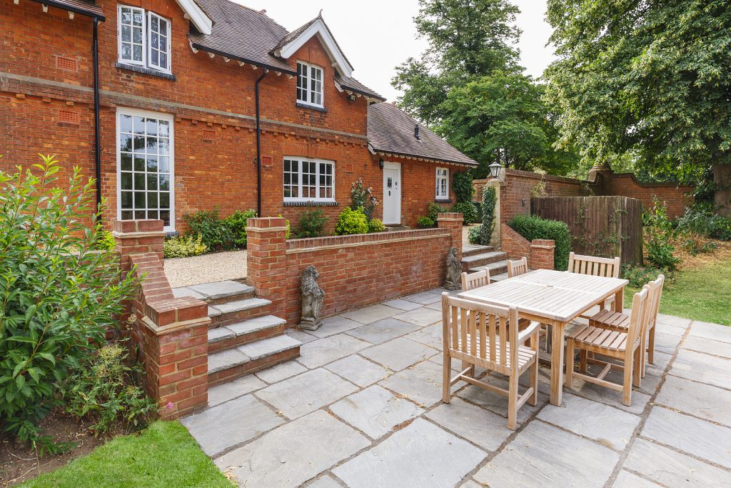 Large Victorian house with outdoor dining set